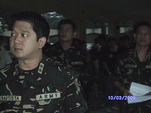 Herbert Bautista - LTC HERBERT M BAUTISTA MNSA (GSC) RES PA inspects the troops prior to deployment for Rehabilitation Operations on areas affected by TS Typhoon Ketsana (Ondoy).