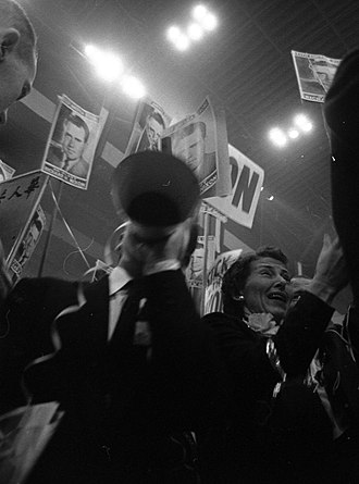 1956 Republican National Convention - Convention-goers at the 1956 Republican National Convention holding signs for Richard Nixon.