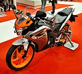 2011 Honda CBR125R orange gray Motosalon.jpg