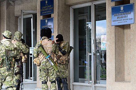 Pro-Russian insurgents occupying the Sloviansk city administration building, 14 April 2014 2014-04-14 Sloviansk city council - 2.jpg