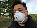 2017. Safety mask used in vicinity of Lambda cyhalothrin application. Bilguun.O (Governance Activity Coordinator, United Nations REDD) demonstrates. Bulgan Province, Mongolia. (39581866751).jpg