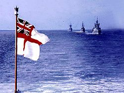 The White Ensign flying from a Royal Navy vessel