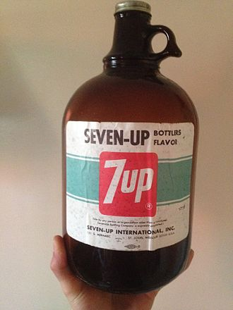 Soft drink - A jug of bottler's flavor for 7-Up. The syrup-like concentrate lacks sugar and is sold to franchisees to refill.