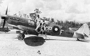 No. 79 Squadron RAAF - A No. 79 Squadron pilot (wearing uniform) and two members of the squadron's ground crew posing with a Spitfire Mk. VIII at Morotai during September 1945