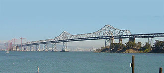 Eastern span replacement of the San Francisco–Oakland Bay Bridge - Construction on the skyway in progress at left in 2004, with main span counterweight support columns in place at right of center