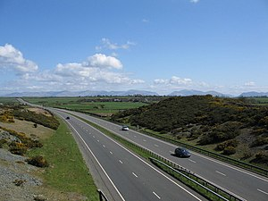 A55 road - Looking east along the road in Anglesey with the mountains of Snowdonia in the background.