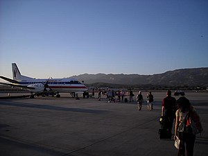 Santa Barbara Municipal Airport - Passengers boarding an American Eagle Saab 340B turboprop aircraft for a flight to Los Angeles in October 2008