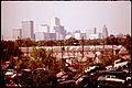 AUTOMOBILE JUNKYARD WITH HOUSTON SKYLINE IN BACKGROUND - NARA - 545851.jpg