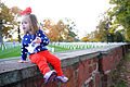 A child takes a break during a Flags Across America event Nov. 2, 2013, at Arlington National Cemetery in Arlington, Va 131102-G-ZX620-221.jpg