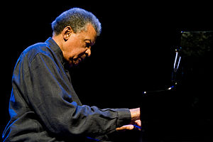 "Music in the movement against apartheid - Jazz pianist Abdullah Ibrahim (pictured here in 2011) composed ""Mannenberg"", an instrumental piece that invoked themes of freedom and cultural identity."