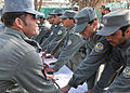 Afghan Uniform Police graduates of officer candidate school pledge to serve and protect with honor during a graduation ceremony at the Kandahar training center in Afghanistan Jan 120129-F-FR276-107.jpg