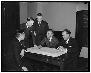 E. K. Jett - E.K. Jett and four aviation leaders discuss the use of radio technology to improve air safety, at the February, 1937, Air Safety Conference in Washington.  Jett is second from left.