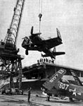 Aircraft are loaded on USS Boxer (CV-21) at NAS Alameda in 1950.jpg