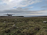 Photograph of an aircraft landing at Foula Airfield