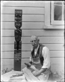 Albert Percy Godber working on a Maori carving, circa 1932 ATLIB 315065.png
