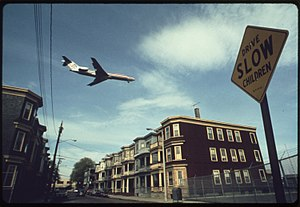 East Boston - An airplane approaching Logan International Airport in 1973.