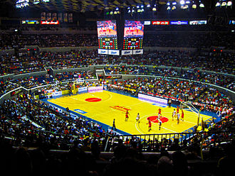 "Smart Araneta Coliseum - The Araneta Coliseum with the ""Big Cube"" LED display during a PBA game in 2011. This photo was taken before the naming rights with Smart Communications took effect."
