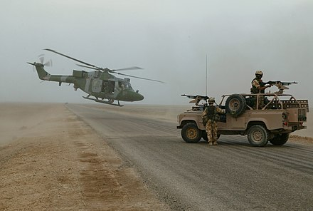 British forces south of Basra Airport, Iraq, November 2003. Army Air Corps Lynx linking up with RAF regiment vehicle patrol. MOD 45142954.jpg