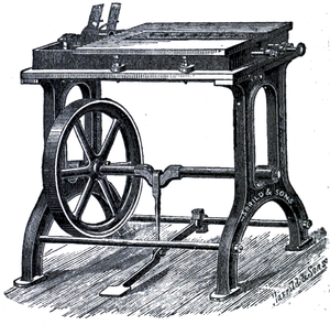 Cross-hatched drawing of a table-like bench with an inner wheel connected by axle to a floor peddle.
