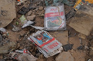 Video game crash of 1983 - Partially-surviving cases and cartridges retrieved during the 2014 excavation of the Alamogordo, New Mexico landfill Atari had used in 1983. E.T., Centipede, and other Atari materials can be seen.