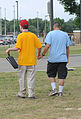 Athlete Chris Jernigan, left, walks to an event with assistance from U.S. Air Force Airman 1st Class Nicholas Guevara, a student with the 332nd Training Squadron, at the 2010 Mississippi Special Olympic games at 100515-F-BD983-016.jpg