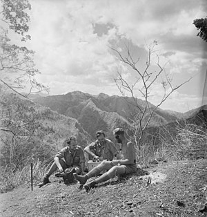 Battle of Timor - Signaller Keith Richards, Corporal John Donovan and Sergeant Frank Press (left to right), from the Australian 2/2nd Independent Company, using a radio on a mountain top in Japanese-occupied Timor, in about November 1942. (Photograph by Damien Parer.)