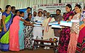 "Bandaru Dattatreya distributed cheques to the beneficiaries at the inauguration of the ""Job Mela and Loan Mela-2017"", at Keshav Memorial High School, in Hyderabad.jpg"