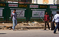 Bangalore guy crossing street on cellphone November 2011 -10-2.jpg