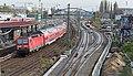 Berlin Ost DB 143 848 met RB 14 naar Nauen langs Warschauer Brücke (15541625030).jpg