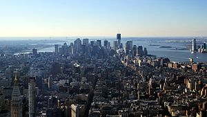 The Lower Manhattan skyline in December 2011, seen from the Empire State Building. One World Trade Center can be seen, under construction, in the background.