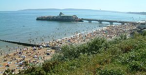 Dorset - The beach near Bournemouth Pier. Dorset's coastline is a major attraction for tourists.