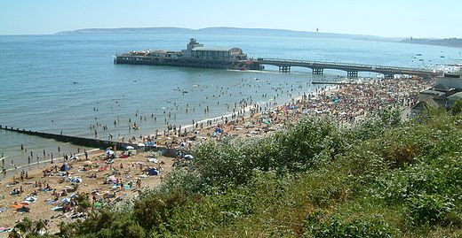 The beach near Bournemouth Pier. Dorset's coastline is a major attraction for tourists.