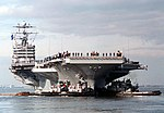 Bow view of USS George Washington (CVN-73) being assisted by tugs during departure for Operation Joint Endeavor 960126-N-6442M-002.jpg