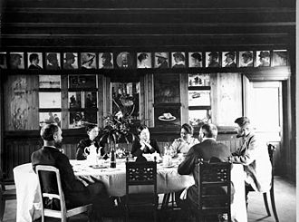 Skagen Painters - Dining room in Brøndums Hotel (ca. 1891) showing some of the group and the panel of their portraits