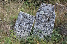 Two tombstones askew