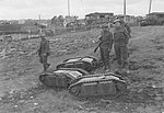 British troops with Goliath tracked mines.jpg