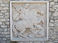Budapest. Castle Hill, Royal Palace. Next to Corvin gate, the north end wall. St. George the dragon. Relief.JPG