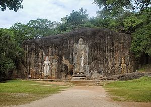 Buduruvagala -  The figures are thought to date from around the 10th century and belong to the Mahayana Buddhist school, which enjoyed a brief heyday in Sri Lanka during this time.