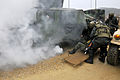 Bulgarian soldiers pull wounded soldiers from a replicated burning Humvee after a simulated improvised explosive device detonation during operational mentor and liaison team (OMLT) training at the Joint 120120-A-RA799-006.jpg