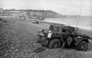 Dieppe Raid - Dieppe's chert beach and cliff immediately following the raid on 19 August 1942. A Dingo Scout Car has been abandoned.