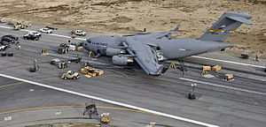"""2009 in aviation - C-17A Globemaster III, 06-0002, """"Spirit of the Air Force"""", on Bagram Air Base runway after inadvertent night belly-landing."""