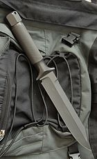 Knife on green backpack