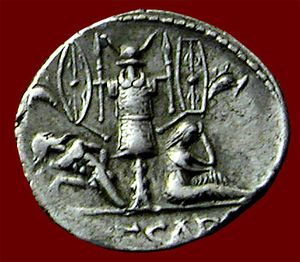 Trophy of arms - Roman Denarius circa 46-45 BC, depicting a trophy of arms tropaion from the Gallic Wars of Julius Caesar showing a captured Gaul on one side and a mourning female symbolizing Gallia, defeated, on the other