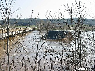 Early Spring 2008 Midwest floods - A house nears a bridge in northern Arkansas