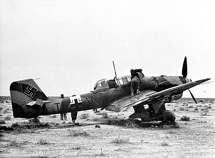 A Ju 87 B of 5/StG 2 is examined by British troops after making an emergency landing in the North African desert, December 1941. Captured Ju 87B in North Africa 1941.jpg