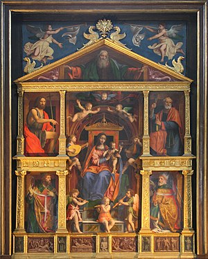 Basilica of San Magno, Legnano - Polyptych depicting the Enthroned Madonna and Child surrounded by Angels with Musical Instruments (1523) by Bernardino Luini