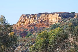 Cliffs in Coyote Hills, Fullerton, CA, seen from Ralph B. Clark Park.jpg