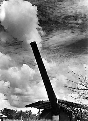 Battle of Singapore - One of Singapore's 15-inch coastal defence guns elevated for firing