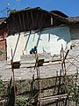 Construction Worker with Scaffolding - Gjirokastra - Albania (42411928841).jpg