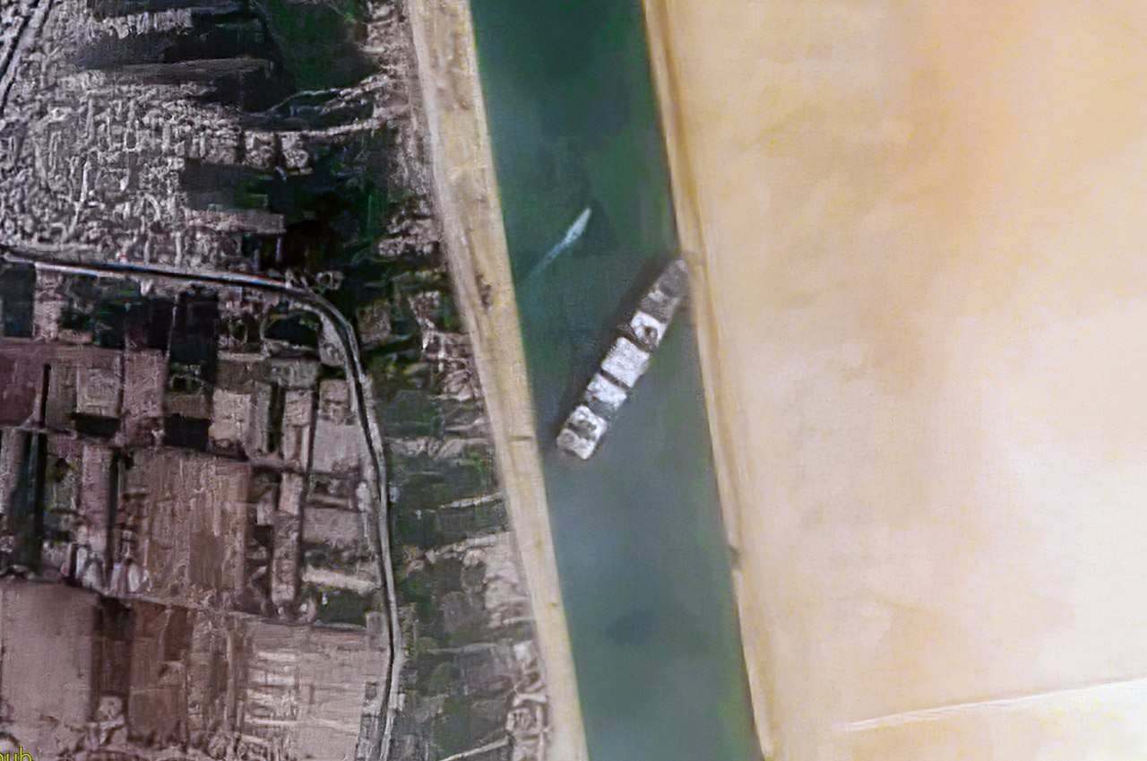 1280px-Container_Ship_%27Ever_Given%27_stuck_in_the_Suez_Canal%2C_Egypt_-_March_24th%2C_2021_cropped.jpg